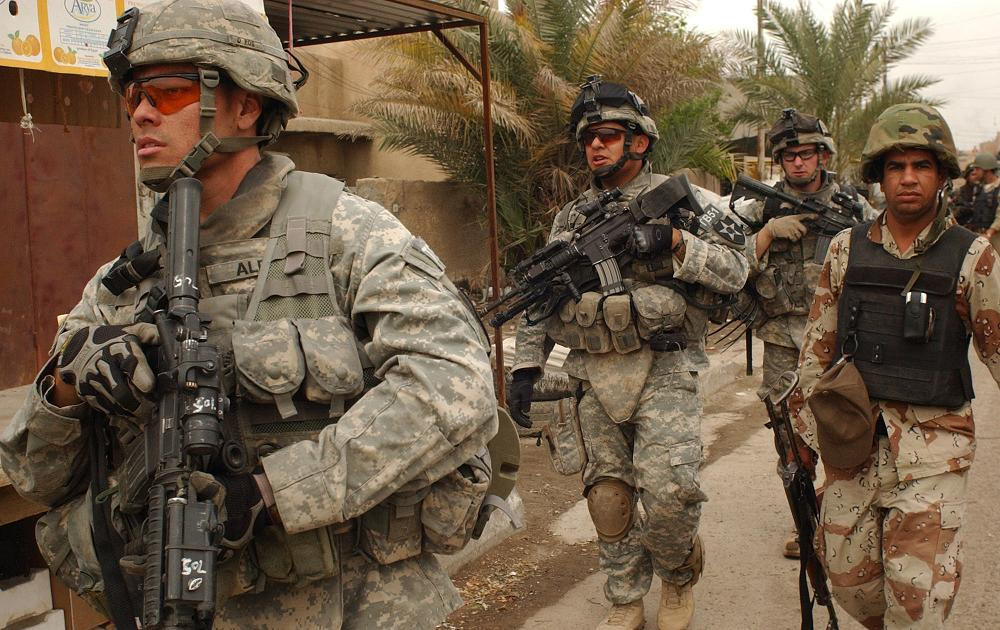 U.S. Army and Iraqi National Police on patrol, March 2007. Defense Department photo.