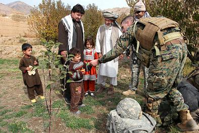 U.S. Marine Capt. Patrick Francescon gives candy to Afghan children  during a patrol with U.S. Army and Afghan national army soldiers in  Depak Valley, Afghanistan, Oct. 30, 2009. The Marines are assigned  to the 1st Battalion, 12th Marine Regiment, and the soldiers are  assigned to the 405th Civil Affairs Battalion.  U.S. Army photo by Sgt. Teddy Wade.